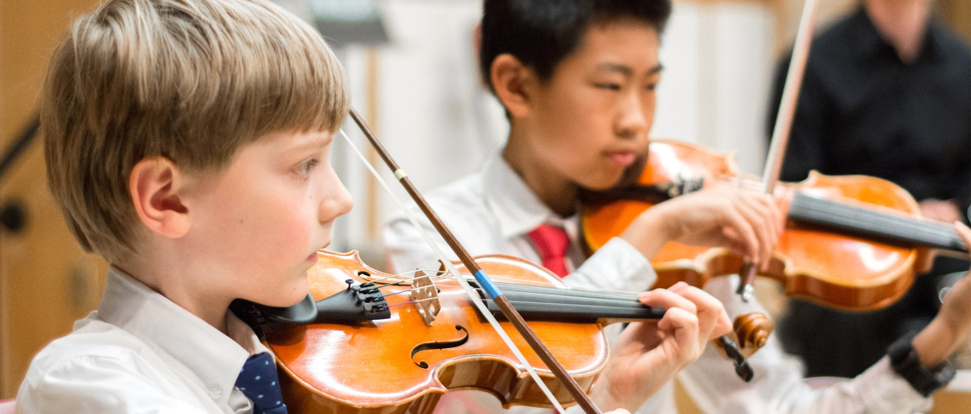 Two boys play the violin