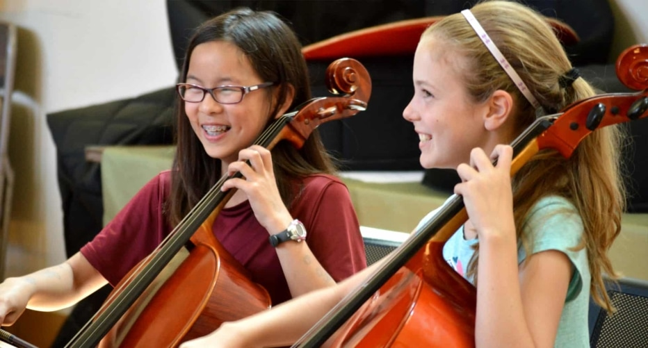 Two girls rehearse cello in Music on the Hill summer camp